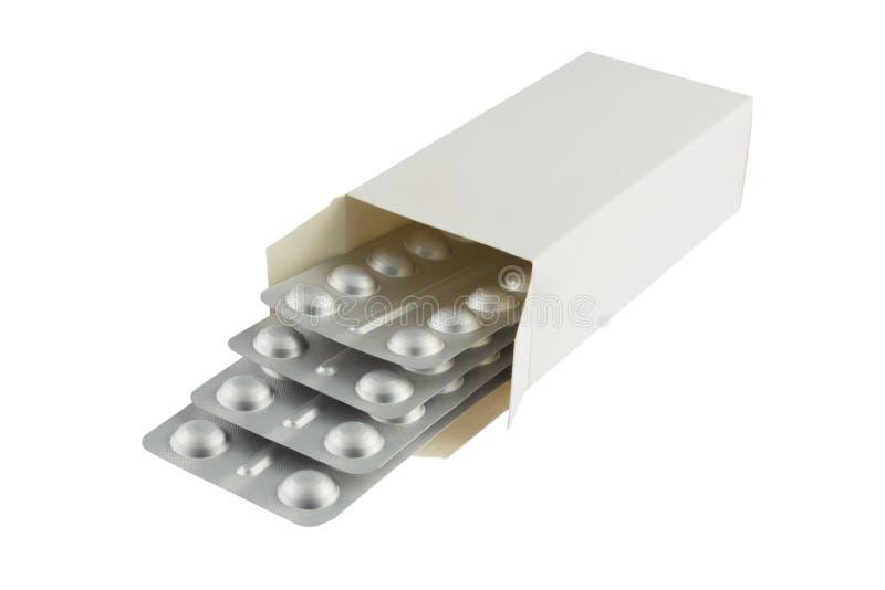 Boursouflure avec des pilules en paquet photo libre de droits