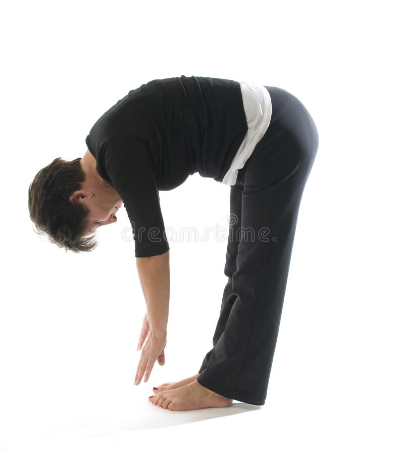 Bout droit femelle de tendon du jarret de contact de tep de position de yoga photo stock