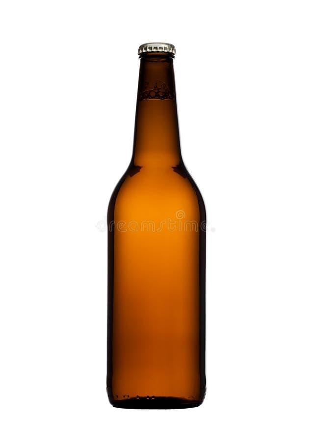 Bouteille à bière en verre de Brown avec le chapeau jaune d'isolement photo stock