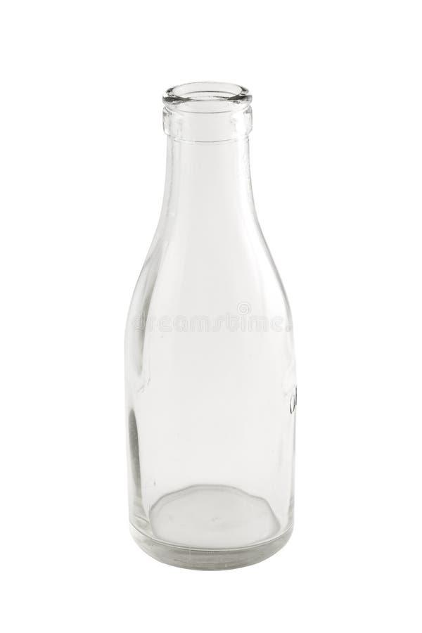 Bouteille à lait vide d'isolement avec le chemin de découpage photographie stock