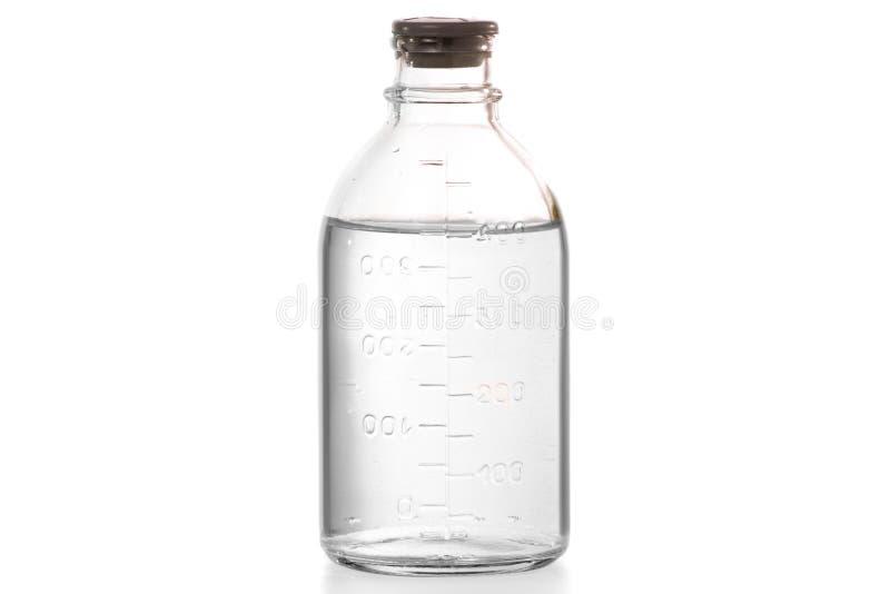 Bouteille avec la désinfection médicale d'alcool photographie stock