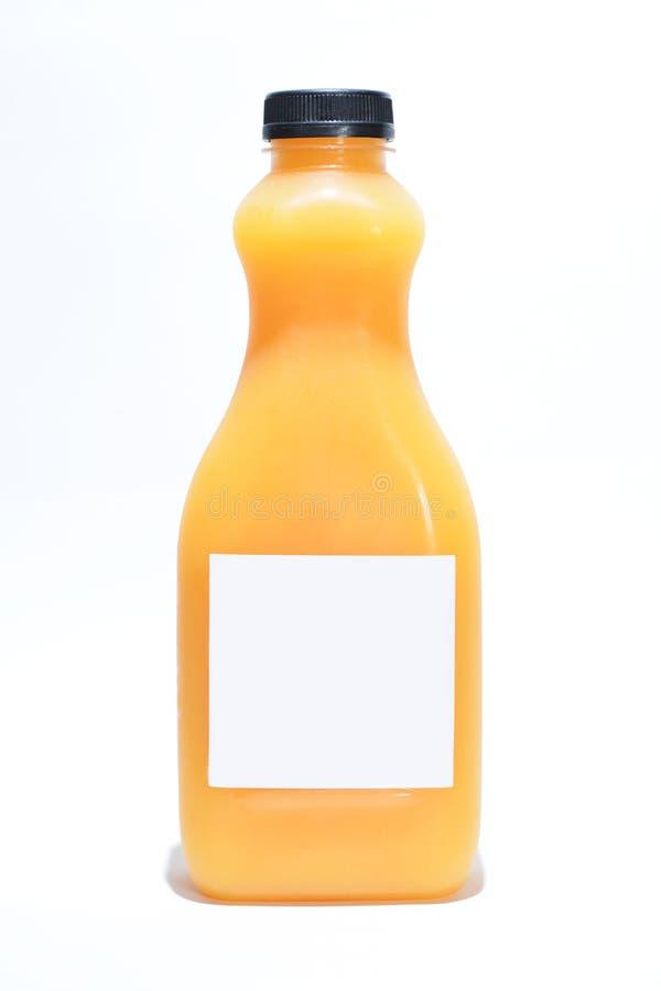 Bouteille avec le jus d'orange sur le fond blanc image stock