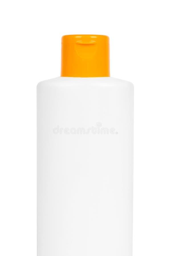 Bouteille blanche en plastique de shampooing avec le chapeau orange d'isolement sur le fond blanc Distributeur de gel pour des so image libre de droits
