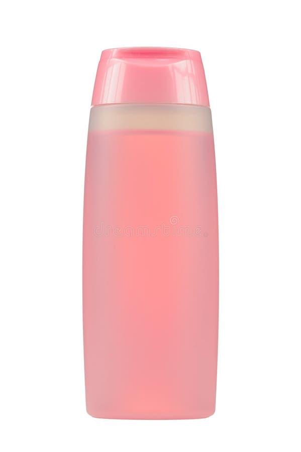 Bouteille cosmétique avec le liquide rose (tonique facial) d'isolement sur le fond blanc images libres de droits