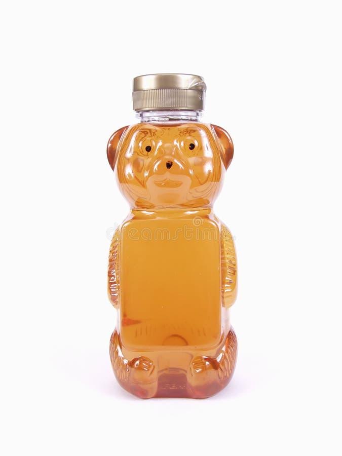 Bouteille d'ours de miel photographie stock