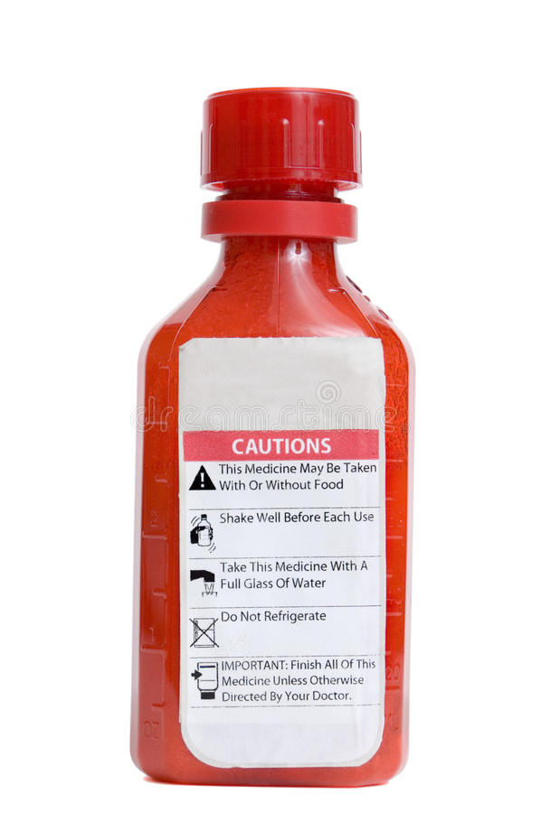 Bouteille de médecine avec les étiquettes d'avertissement image stock