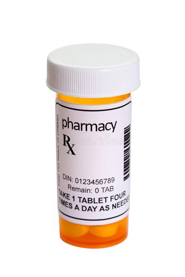Bouteille de pilule jaune photo libre de droits