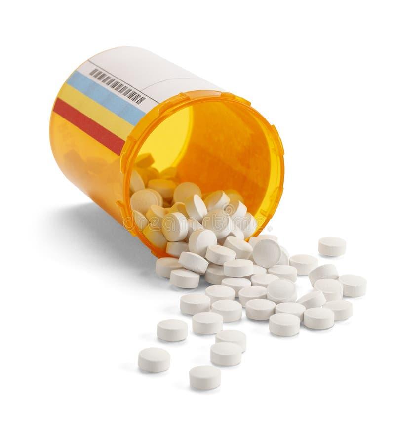 Bouteille de pilule renversée images stock