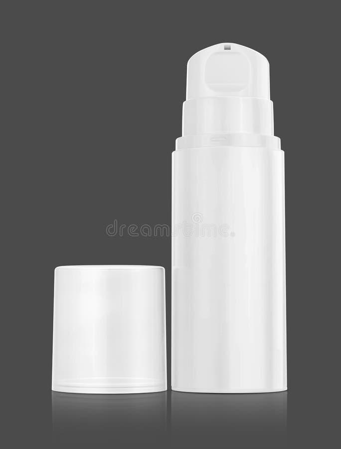 Bouteille de pompe pour la crème et lotion d'isolement sur le fond gris images libres de droits