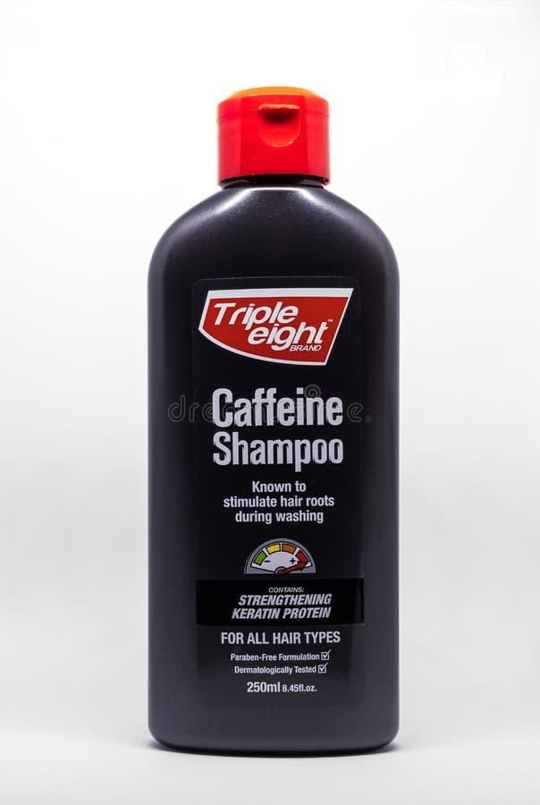 Bouteille de shampooing de caféine du triple huit image libre de droits