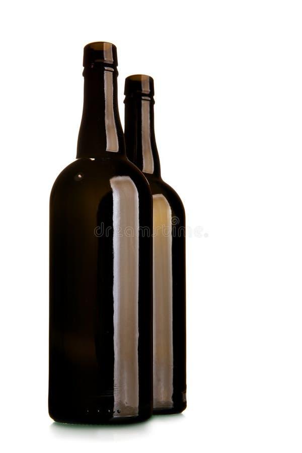 Bouteille de vin deux vide de verre foncé photographie stock libre de droits