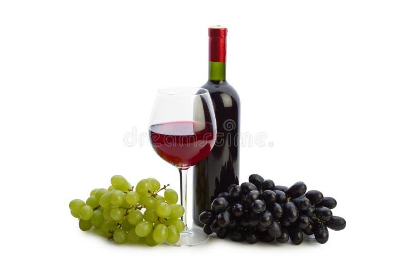 Bouteille de vin et de raisins image libre de droits