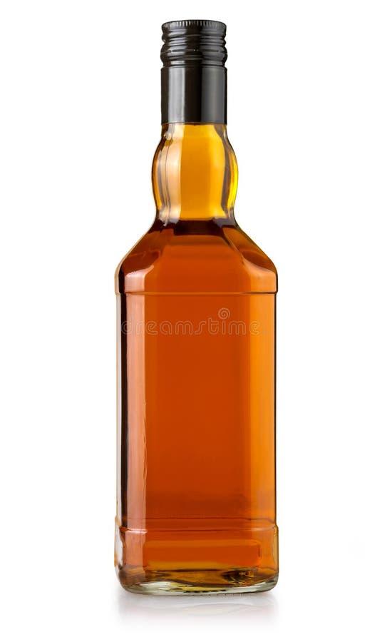Bouteille de whiskey sur le blanc photographie stock libre de droits
