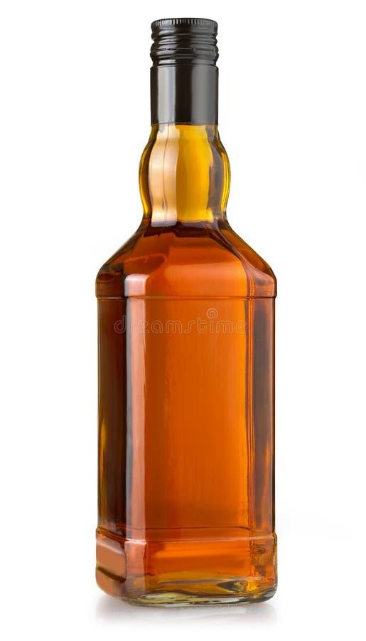 Bouteille de whiskey sur le blanc image libre de droits