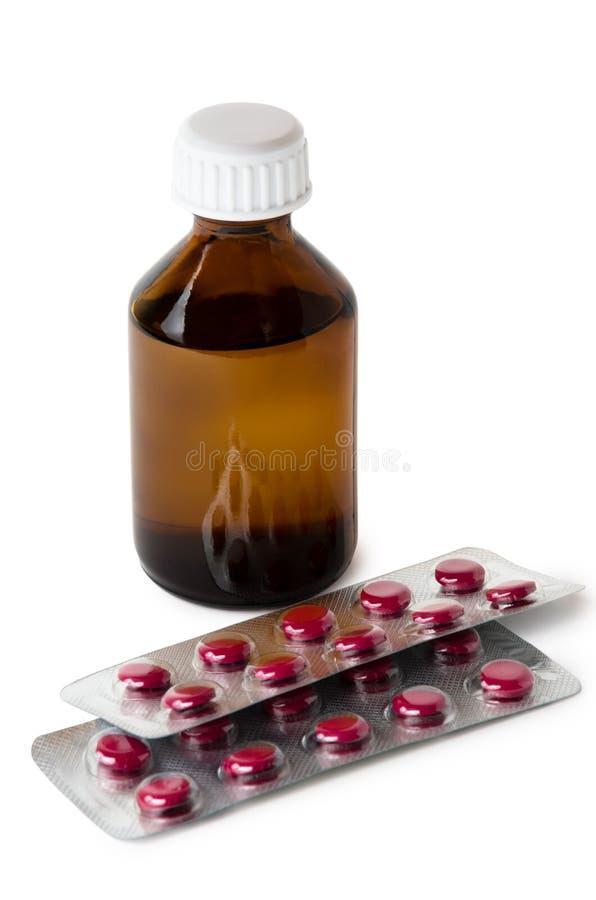 Bouteille du ginseng et de la boursouflure sibériens d'extrait avec des pilules image stock