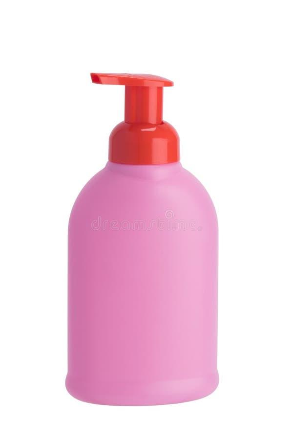 Bouteille en gros plan et rose avec le distributeur avec du savon liquide, sur un fond blanc photo libre de droits