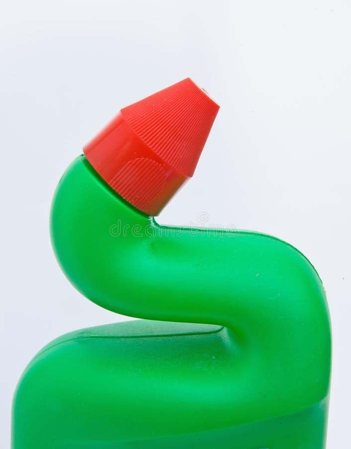 Bouteille en plastique avec le cou formé par canard. photographie stock libre de droits