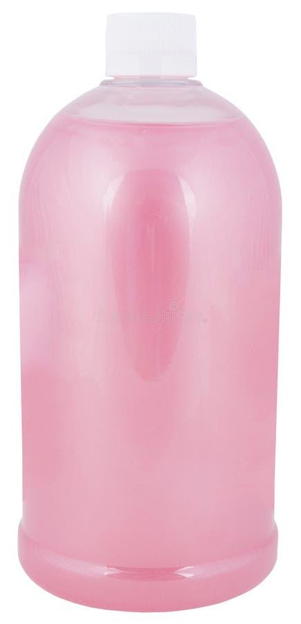 Bouteille en plastique complètement avec le détergent rose photo libre de droits