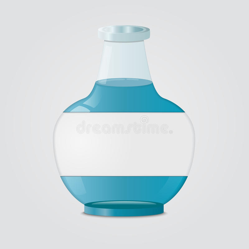Bouteille en verre avec le liquide bleu photographie stock