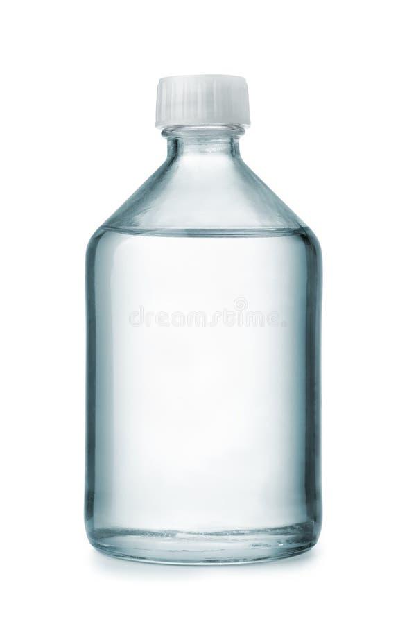 Bouteille en verre chimique avec le liquide transparent photographie stock