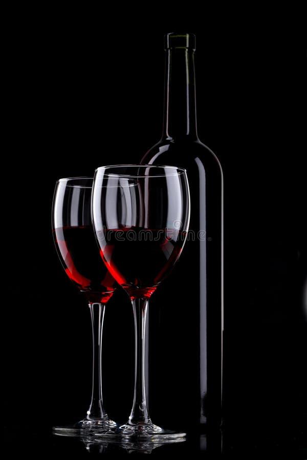 Bouteille et glace de vin rouge photographie stock