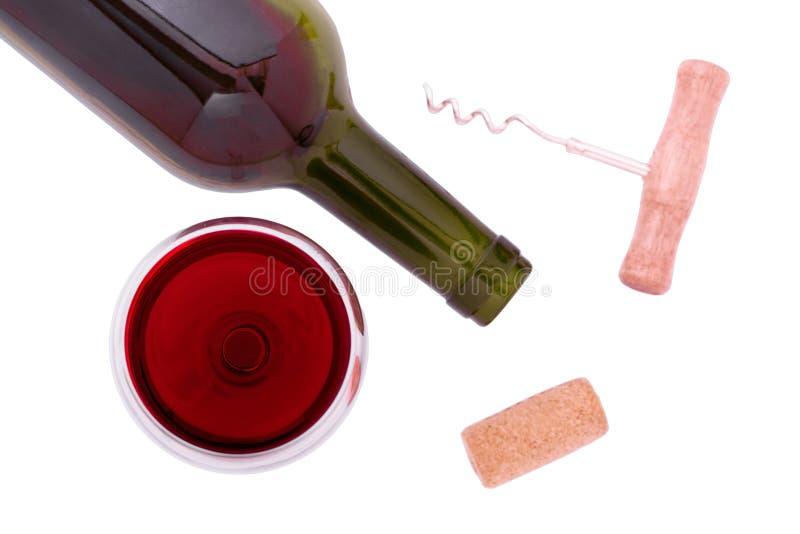 Bouteille et glace de vin rouge sur le fond blanc Vue exceptionnellement supérieure photos stock