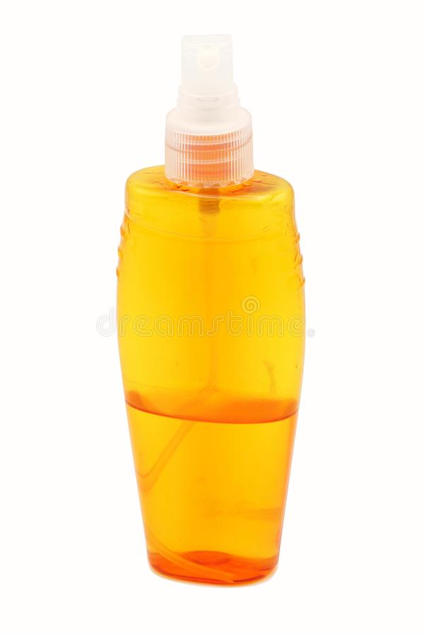 Bouteille orange de jet sur un fond blanc disposition image stock