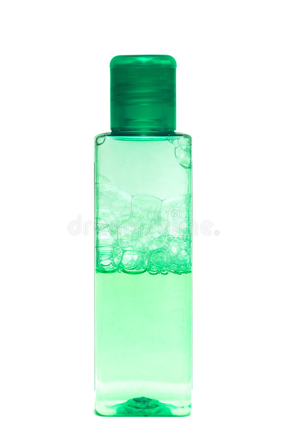 Bouteille verte avec le shampooing image stock