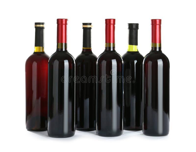 Bouteilles avec le vin rouge photographie stock