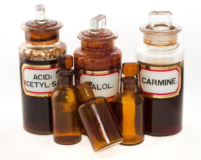 Bouteilles chimiques démodées images stock