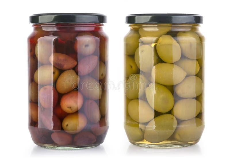 Bouteilles d'olives sur un blanc image stock
