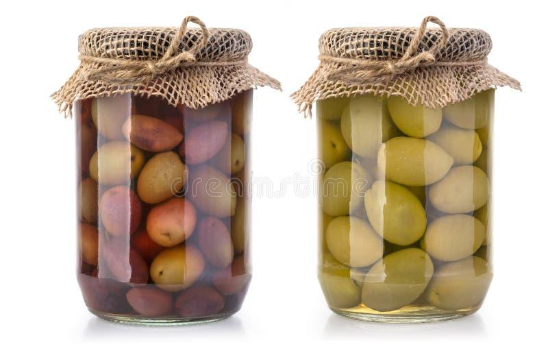 Bouteilles d'olives sur un blanc photo stock