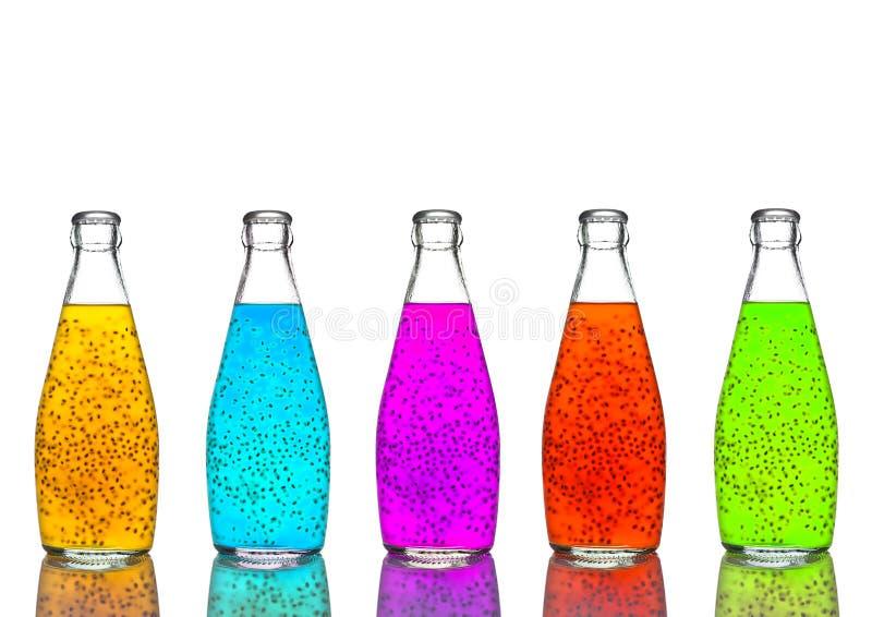 Bouteilles de mélange sain exotique de couleur de jus photographie stock