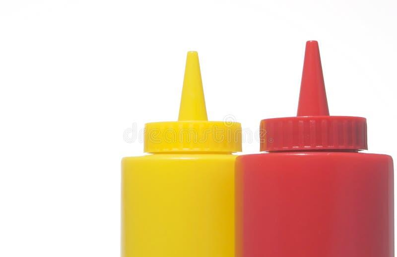 Bouteilles de moutarde et de ketchup image libre de droits