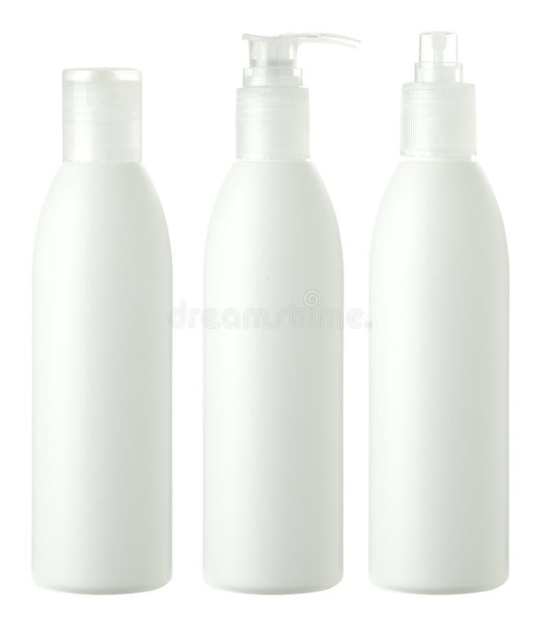 Bouteilles de soin de cheveu d'isolement sur le blanc photographie stock libre de droits