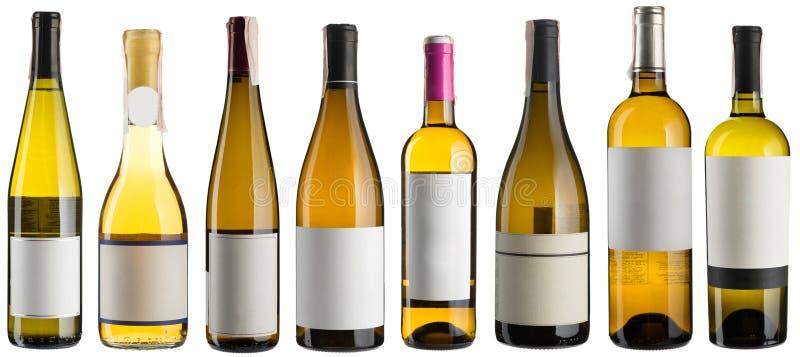 Bouteilles de vin blanc réglées photographie stock