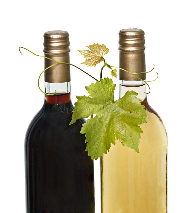 Bouteilles de vin rouge et blanc image libre de droits
