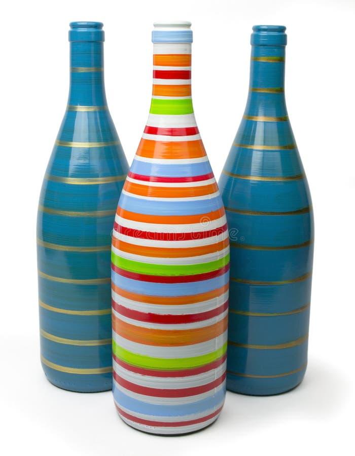 Bouteilles en verre colorées photographie stock