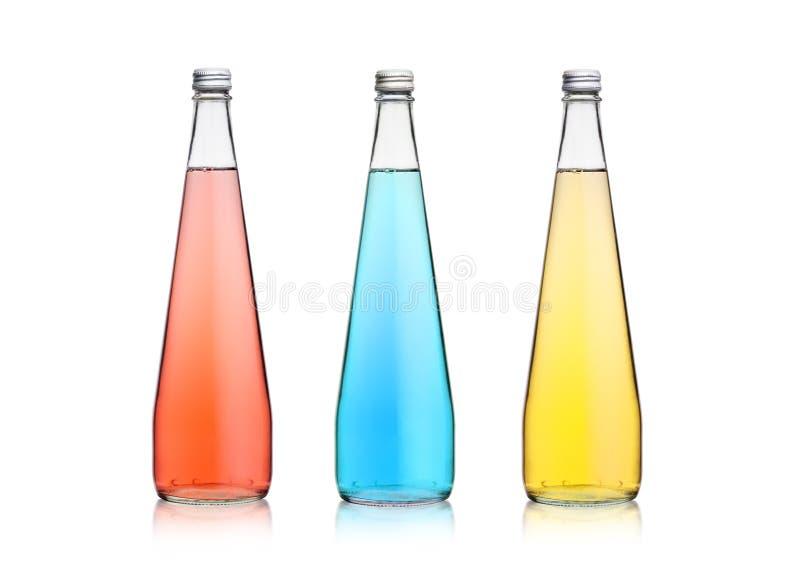 Bouteilles en verre de limonade bleue rose de scintillement de soude image libre de droits