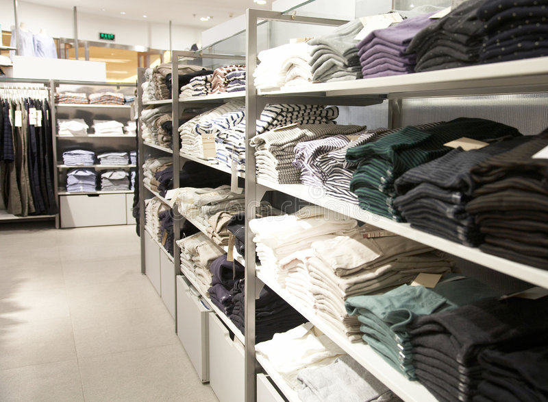 Boutique. Interior of modern clothing shop royalty free stock images