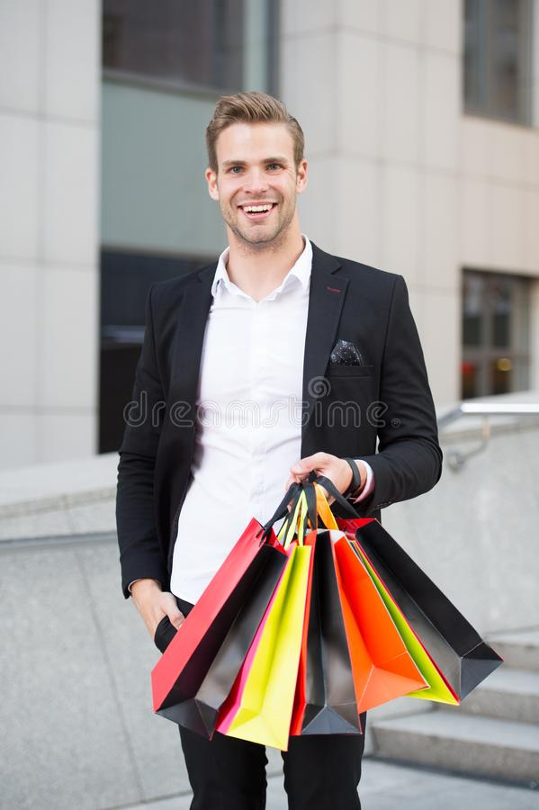 Boutique gallery shopping. Man shopper carries shopping bags urban background. Successful businessman choose only stock photos