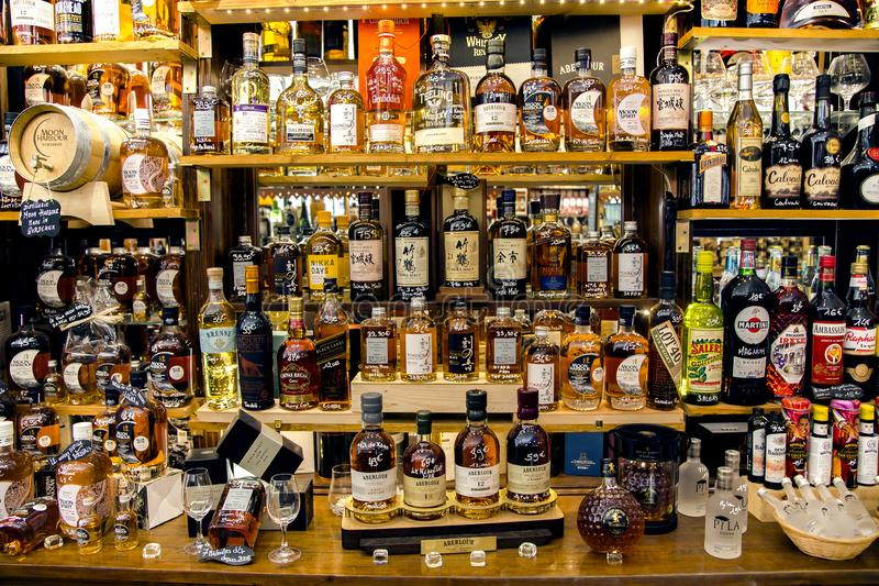 Boutique with a large selection elite of alcoholic beverages. FRANCE, BORDEAUX, MAY, 19, 2019 - French boutique with a large selection elite of alcoholic stock photography