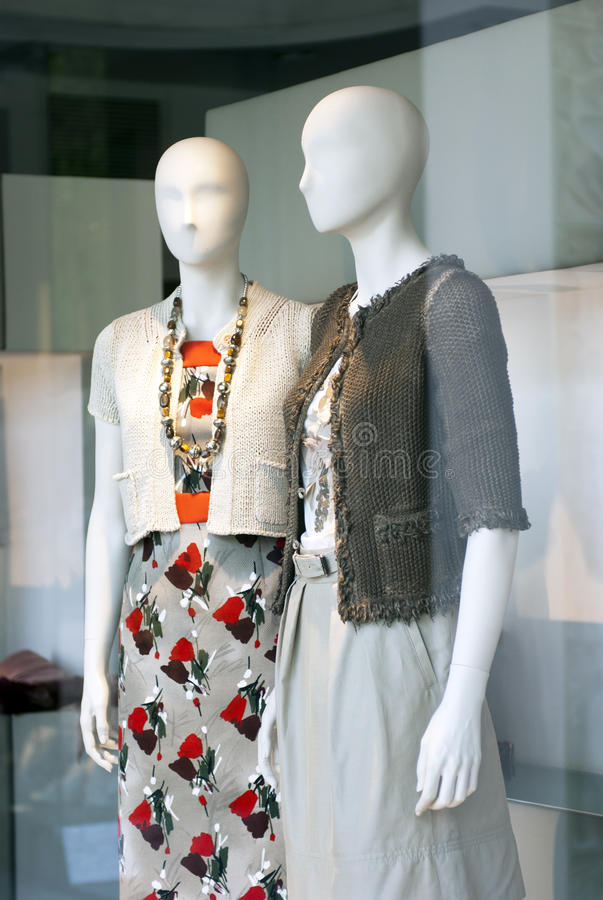 Boutique window. With dressed mannequins stock photo