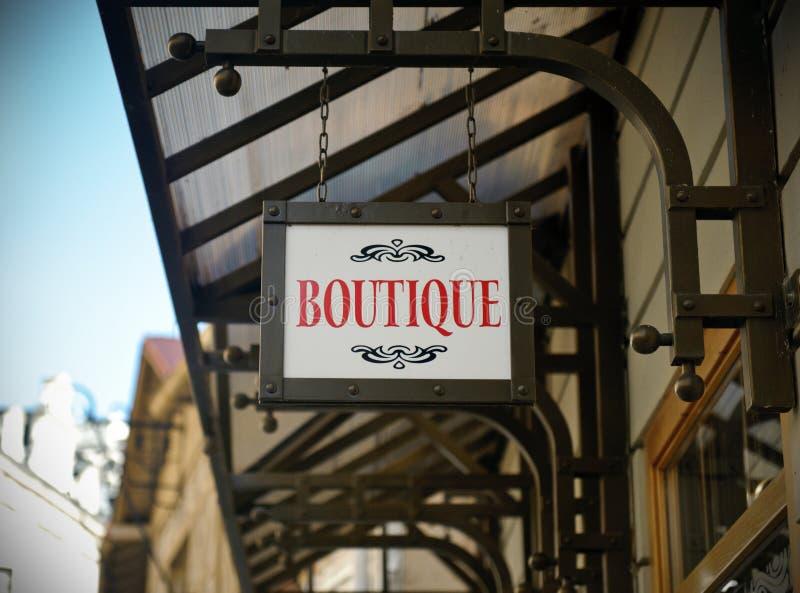 boutiquen shoppar tecknet arkivfoto