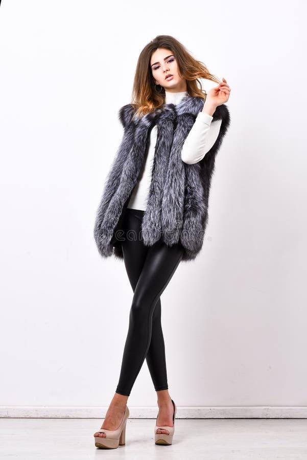 Boutiques selling fur. Woman makeup face wear fur vest white background. Luxury fur accessory clothes. Fashion trend stock photos