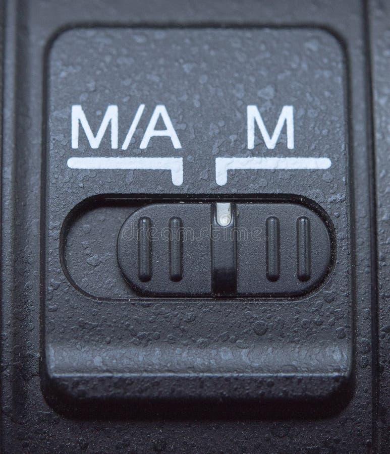 Bouton automatique et mannual de lentille de foyer photographie stock