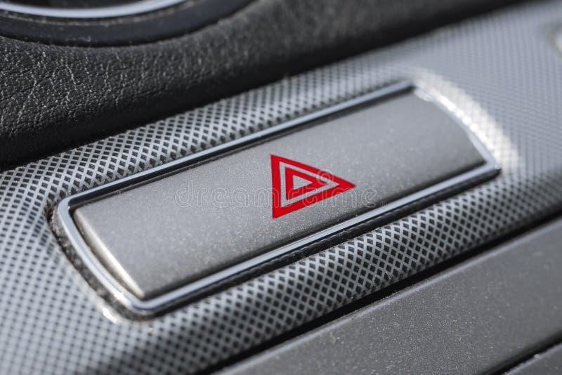 Bouton d'avertissement de risque de voiture images stock