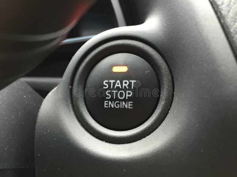 Bouton de moteur d'arrêt de début photographie stock libre de droits