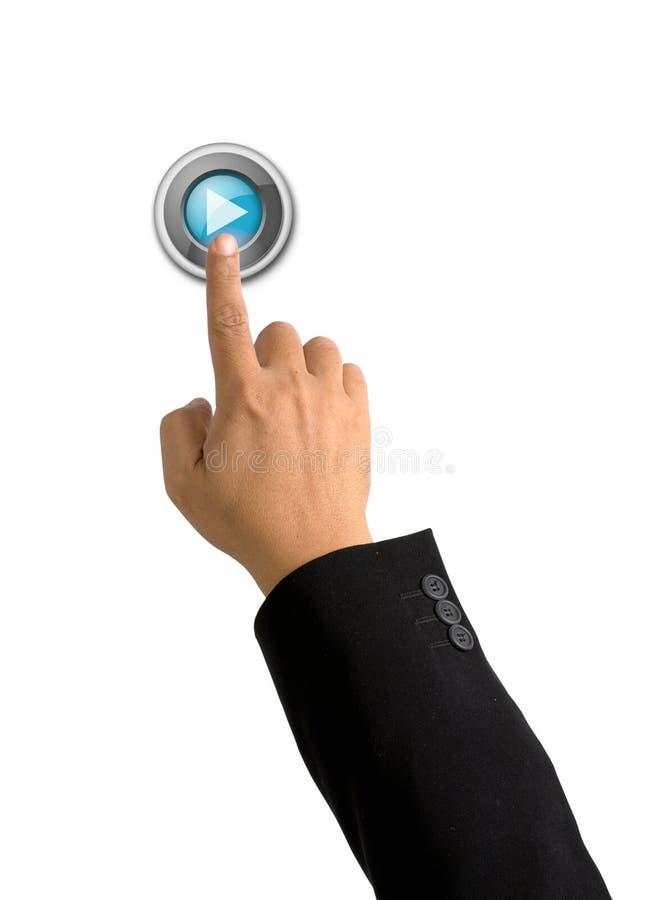 Bouton de pièce de poussée d'index sur le blanc photographie stock libre de droits