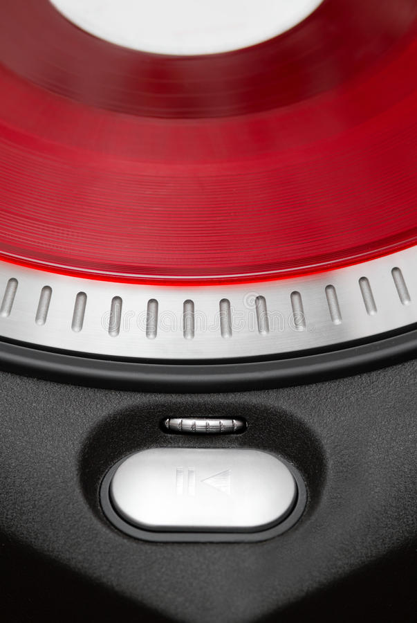 Bouton de pièce sur le tourne-disque de vinyle images libres de droits